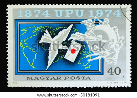 HUNGARY - CIRCA 1974: A stamp printed in Hungary showing dove with envelope circa 1974 - stock photo