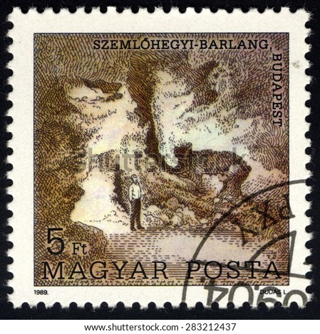 HUNGARY - CIRCA 1989: A stamp printed in Hungary shows Szemlohegy cave, Budapest, with the same inscription, from the series â??10th World Speleology Congress, Sofia. Cavesâ?, circa 1989 - stock photo