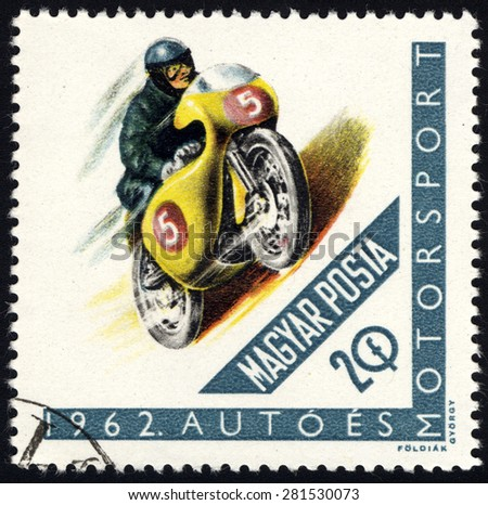 HUNGARY - CIRCA 1962: A stamp printed in the Hungary shows Racing Motorcyclist, circa 1962 - stock photo