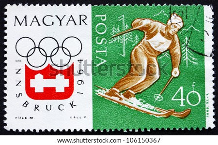HUNGARY - CIRCA 1963: a stamp printed in the Hungary shows Slalom, Alpine Skiing, Winter Olympic sports, Innsbruck 64, circa 1963 - stock photo
