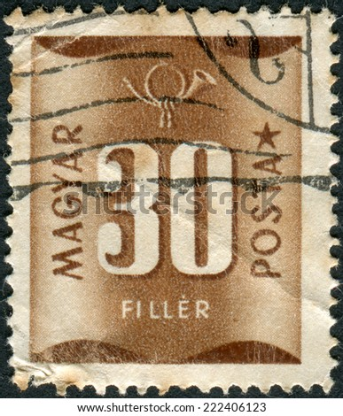 HUNGARY - CIRCA 1951: Postage stamp (dues) printed in Hungary, shows a number - value and postal horn, circa 1951 - stock photo