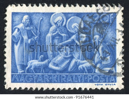 HUNGARY - CIRCA 1943: stamp printed by Hungary, shows relief Nativity, circa 1943 - stock photo