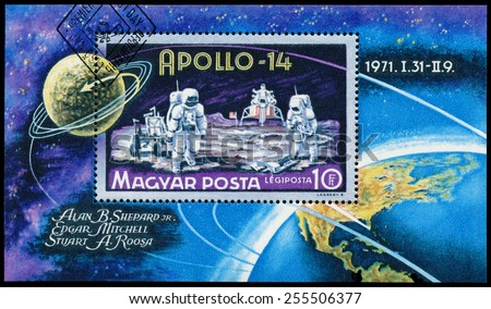 HUNGARY - CIRCA 1971: Stamp printed in Hungary, shows Apollo 14 with astronauts, circa 1971 - stock photo