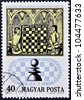 HUNGARY - CIRCA 1974: stamp printed in Hungary, shows Chess Players and 13th century manuscript, circa 1974 - stock photo