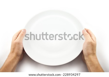 Hunger concept. Man holding empty plate waiting for food isolated on white from top view. - stock photo