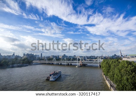 Hungerford Bridge and Golden Jubilee Bridges in London, United Kingdom - stock photo