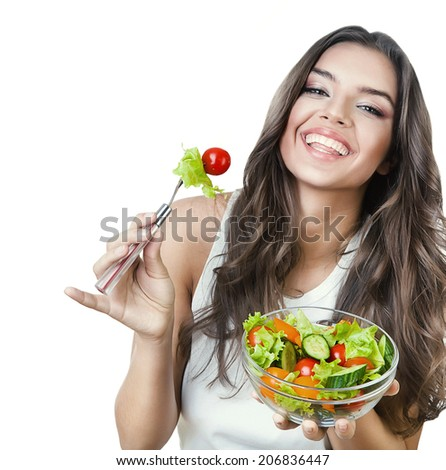 hungry beautiful healthy woman holding salad on white background - stock photo