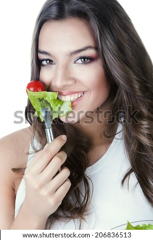hungry beautiful healthy woman with salad on white background - stock photo