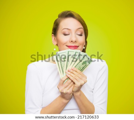 Hungry for money. Portrait, greedy executive, CEO, boss, corporate employee, holding, smelling dollar banknotes tightly, isolated green background. Human emotion facial expression life perception - stock photo