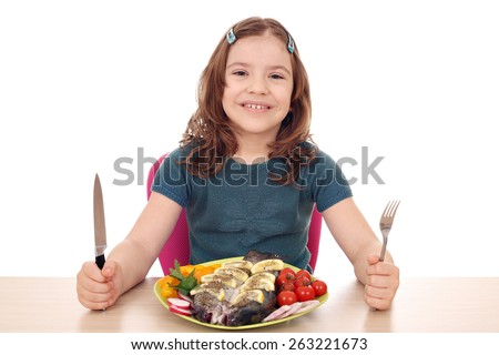 hungry little girl with fish for lunch - stock photo