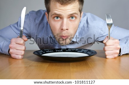 Hungry man waiting to be served - stock photo