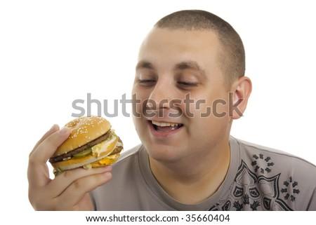 Hungry man with hamburger. - stock photo