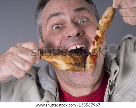 Hungry meat-eating man, no diet - stock photo
