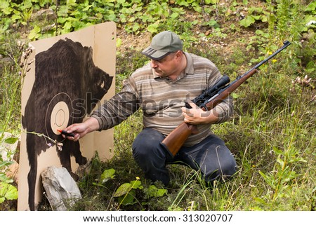 hunter marks traces from shots on target - stock photo