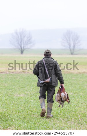 hunter with a catch - stock photo