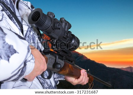 hunter with his rifle - stock photo