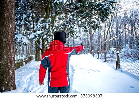hunter with his rifle in forest, hunter holding a rifle and waiting for prey, hunter shooting.Winter - stock photo