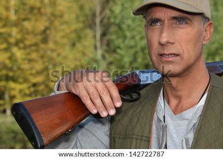 Hunter with shotgun - stock photo