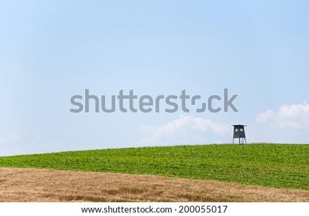 hunting cabin in a rural landscape in Austria - stock photo