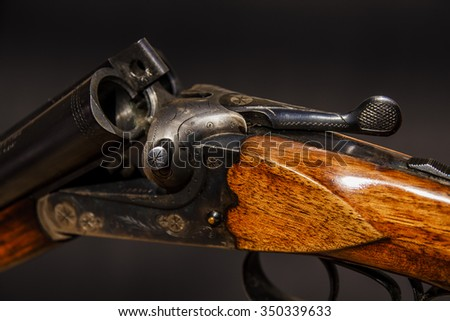 Hunting gun on black backgroung - stock photo