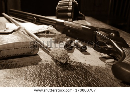 hunting rifle and bullets on the table - stock photo