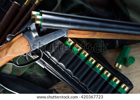 Hunting shotgun with bullets - stock photo