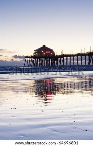 Huntington Beach Pier Blue Hour Low Tide Reflection - stock photo