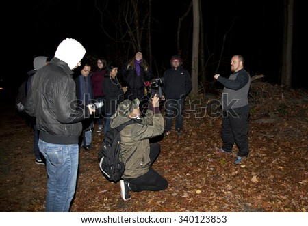 HUNTINGTON, NEW YORK, USA - NOVEMBER 14: Randy talks about the history of Mount Misery road as the Brooklyn Paranormal Society investigate the  location in Long Island.  Taken November 14, 2015 in NY. - stock photo