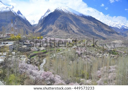 Hunza valley and Karakorum mountain with Cherry blossoms season at Karimabad Pakistan - stock photo