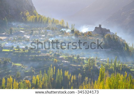 Hunza valley with backlight  and mist in the morning time  - stock photo