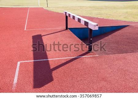 Hurdle in campus stadium  - stock photo