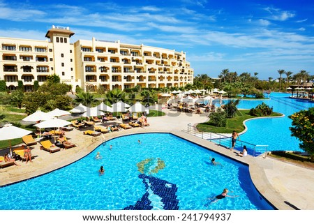 HURGHADA, EGYPT -  DECEMBER 5: The tourists are on vacation at luxury hotel on December 5, 2012 in Hurghada, Egypt. Up to 12 million tourists have visited Egypt in year 2012. - stock photo