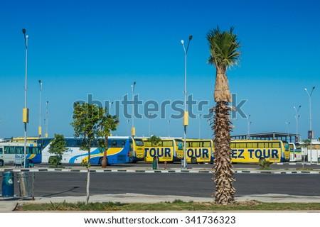 HURGHADA, EGYPT  -  NOVEMBER 6: tourist buses waiting for passengers in Hurghada airport in november 6, 2015 in Hurghada , Egypt - stock photo