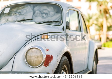 Hurghada, Egypt - October 27, 2015: VW Beetle parked on the street - stock photo