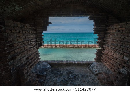 Hurricane-battered window in abandoned Fort Jefferson. Dry Tortugas National Park, Florida. - stock photo