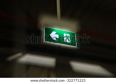 Hurry evacuation then found the exit sign light hanging - stock photo
