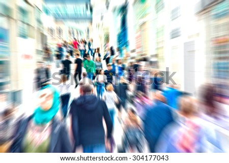 Hurrying crowd of people on the street. Abstract motion picture. - stock photo