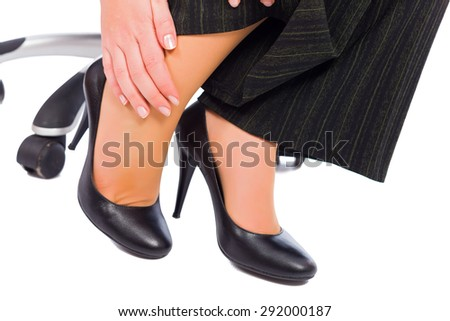 Hurting feet while wearing high heels all day. - stock photo