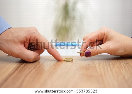 husband and wife are returning wedding rings,divorce concept - stock photo