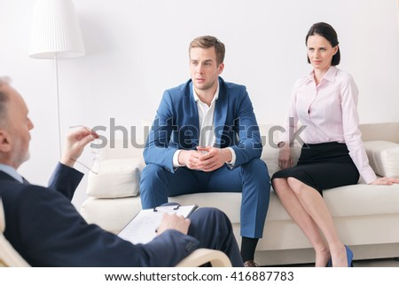 Husband and wife are visiting psychotherapist - stock photo