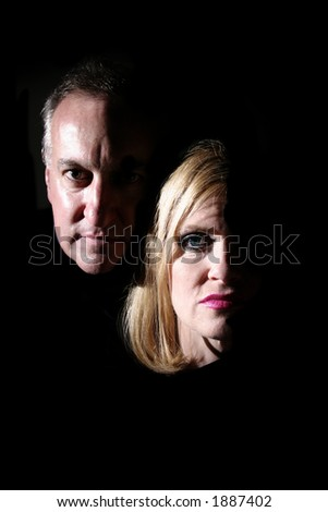 Husband and wife being exposed by coming into the light. - stock photo