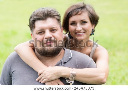 Husband and wife in a summer park - stock photo