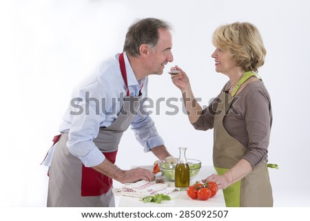 Husband And Wife Preparing Vegetables and salad - stock photo