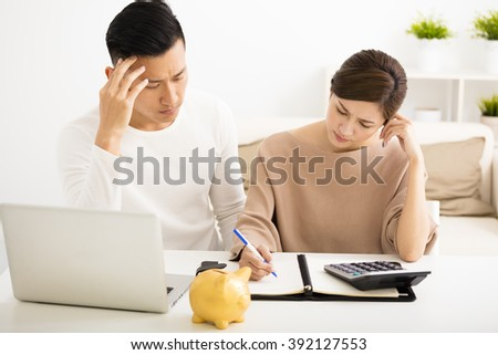 husband and wife with financial stress - stock photo
