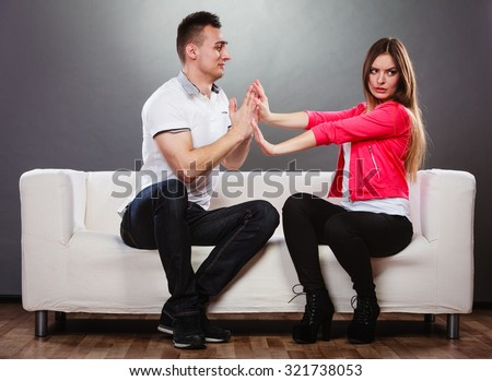 Husband apologizing wife. Unhappy, upset, angry, mad woman refuses apology. Boyfriend trying to convince girlfriend. Man asking for forgiveness. Conflicted couple. Relationship problem. - stock photo