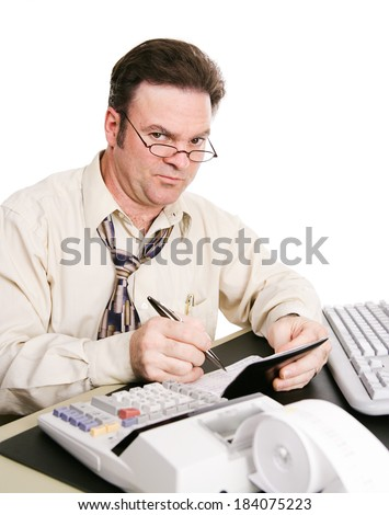 Husband balancing the family checkbook and not pleased with the expenses he's found.   - stock photo