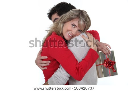 husband giving her wife a present - stock photo