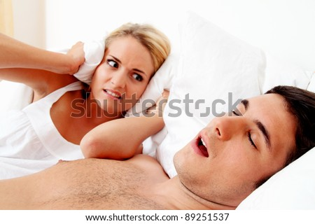 husband snores loud and unpleasant. - stock photo