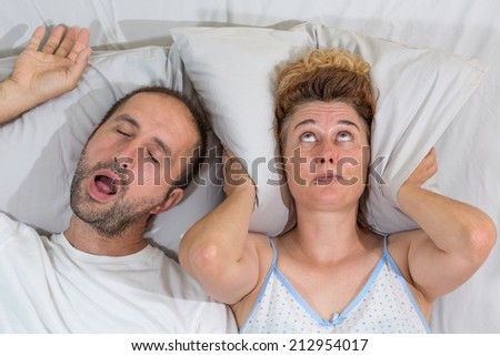 Husband snoring sleep and leaves his wife - stock photo