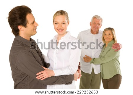 husband wife father in law mother in law standing on white background - stock photo